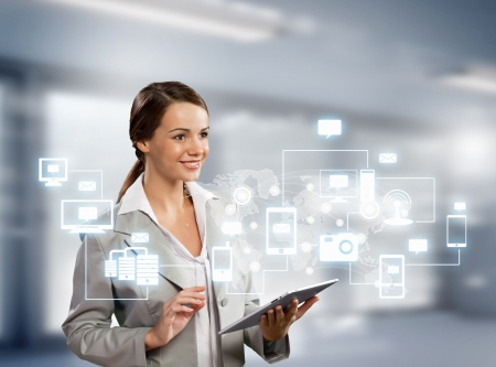 Photo pour Image of businesswoman with tablet pc against high-tech background - image libre de droit