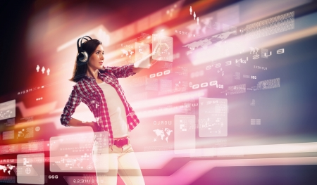 Photo pour Image of young woman with headphones touching virtual screen - image libre de droit