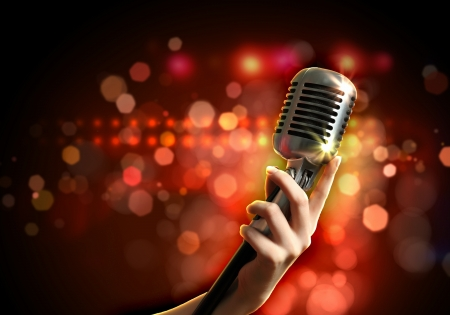 Photo for Female hand holding a single retro microphone against colourful background - Royalty Free Image