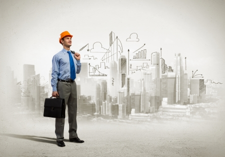 Foto de Image of man engineer in helmet with drafts  Construction concept - Imagen libre de derechos