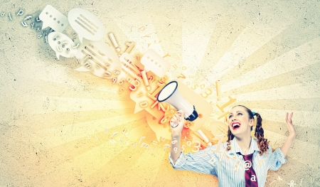 Photo for Funny looking woman speaking with a megaphone - Royalty Free Image