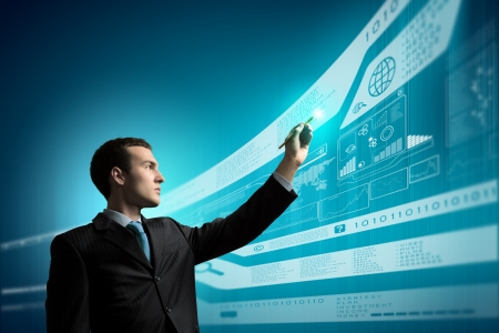 Foto de Image of young businessman touching icon of media screen - Imagen libre de derechos