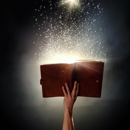 Foto de Close up of human hand holding saint book - Imagen libre de derechos