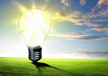 Foto de Image of light bulb against nature background  Ecological concept - Imagen libre de derechos
