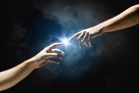 Foto de Michelangelo God s touch  Close up of human hands touching with fingers - Imagen libre de derechos