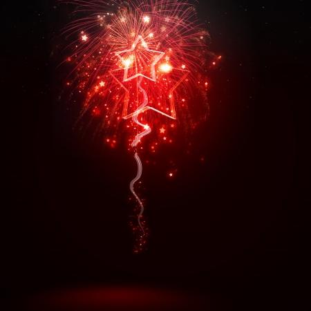 Foto de Background image with red fireworks against dark background - Imagen libre de derechos