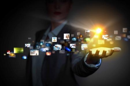 Foto de Application icons in human hand  Wireless technologies - Imagen libre de derechos