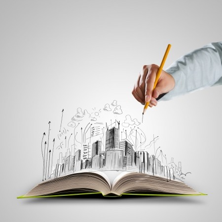 Photo pour Opened book and hand drawing building sketches - image libre de droit