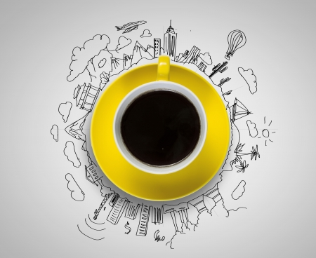 Foto de Cup of coffee with sketches at background - Imagen libre de derechos