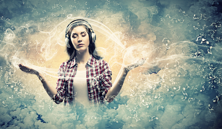 Photo pour Image of young pretty woman with headphones meditating - image libre de droit