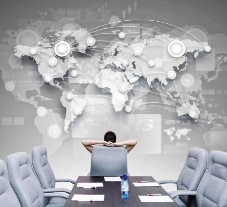 Foto de Businesswoman boss in conference room sitting with back in chair - Imagen libre de derechos
