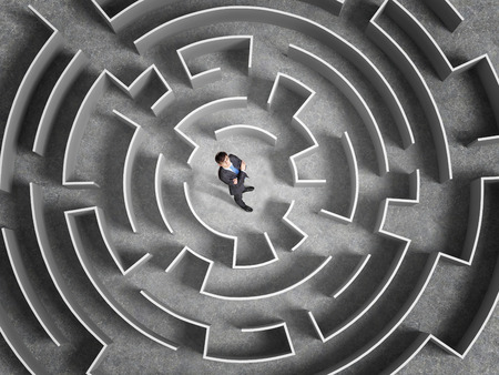 Foto de Top view of successful businessman standing in center of labyrinth - Imagen libre de derechos