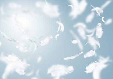 Foto de Abstract background image of white feathers flying in air - Imagen libre de derechos