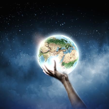 Foto de Close up of human hand holding Earth planet   - Imagen libre de derechos