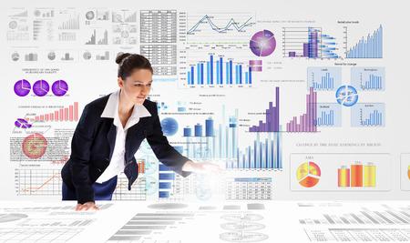 Foto de Young businesswoman analyzing data information of market - Imagen libre de derechos