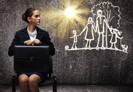 Photo for Young upset businesswoman sitting on chair with briefcase - Royalty Free Image