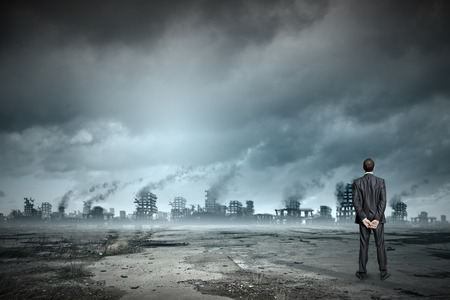 Photo for Rear view of businessman looking at ruins of city - Royalty Free Image