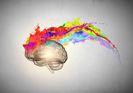 Foto de Conceptual image of human brain in colorful splashes - Imagen libre de derechos