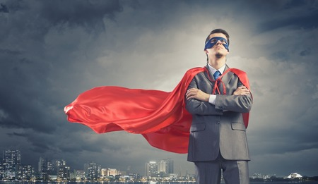 Photo for Young confident super businessman in mask and cape - Royalty Free Image
