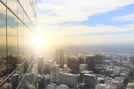 Foto de Top view of modern city in lights of sunset - Imagen libre de derechos