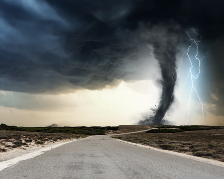 Photo pour Powerful tornado and lightning above countryside road - image libre de droit