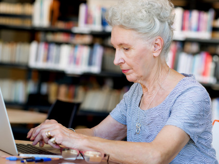 Photo for Elderly lady working with laptop - Royalty Free Image