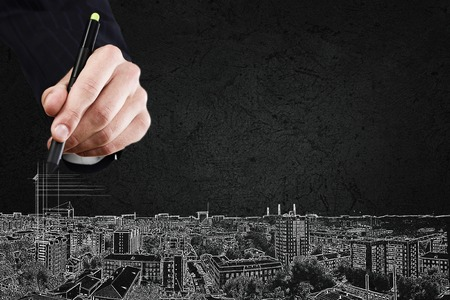 Foto de Close up of hand drawing urban city buildings - Imagen libre de derechos