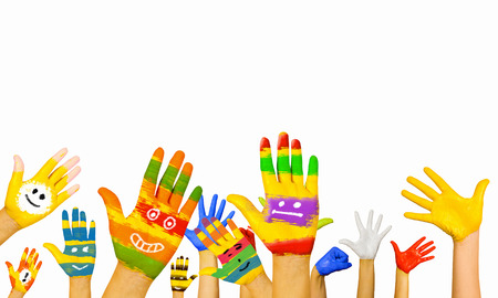 Foto de Image of human hands in colorful paint with smiles - Imagen libre de derechos