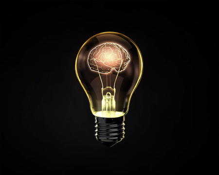Foto de Light bulb with human brain inside on dark background - Imagen libre de derechos