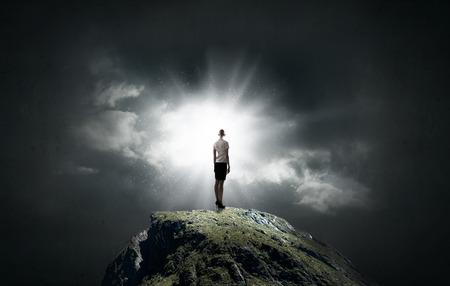 Foto de Rear view of businesswoman standing on top of mountain - Imagen libre de derechos