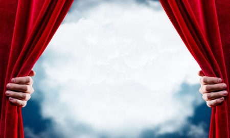 Photo pour Close up of hand opening red curtain. Place for text - image libre de droit