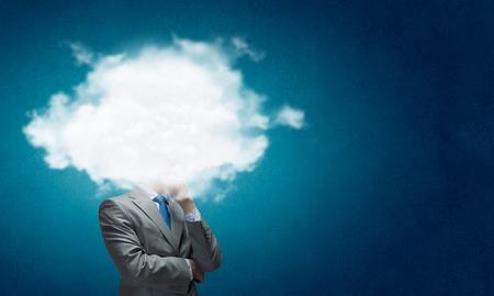 Foto de Businesswoman standing with cloud instead of head - Imagen libre de derechos