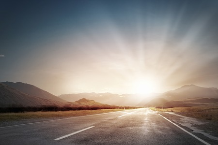 Photo pour Picturesque landscape scene and sunrise above road - image libre de droit
