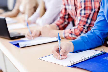 Photo for Young people sitting in classroom at lecture - Royalty Free Image