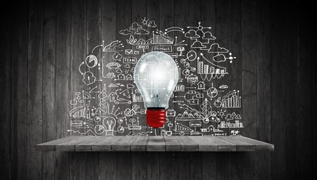 Photo pour Light bulb and drawing business strategy at background - image libre de droit