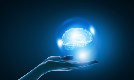 Photo pour Close up of businessman holding digital image of brain in palm - image libre de droit