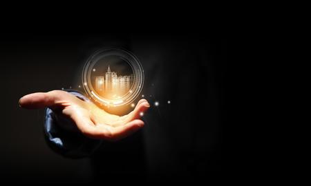 Photo pour Close up of businessman hand holding digital construction model - image libre de droit
