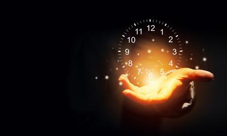 Photo pour Close up of businessman hand holding clock  icon in palm - image libre de droit