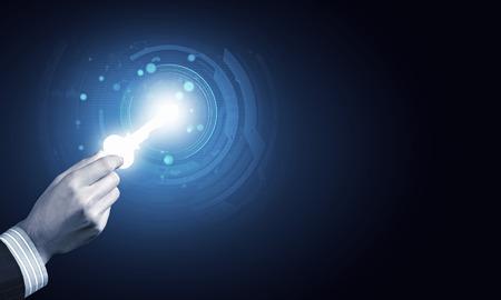 Foto de Close up of human hand with digital key icon - Imagen libre de derechos