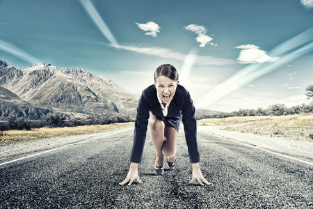 Photo for Young determined businesswoman standing in start position - Royalty Free Image