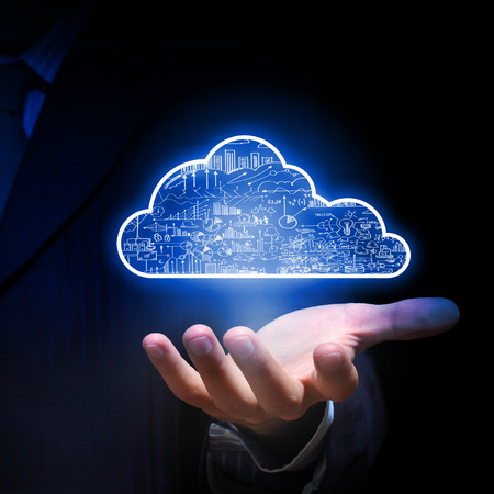 Photo pour Businessman hand holding cloud computing concept in palm - image libre de droit