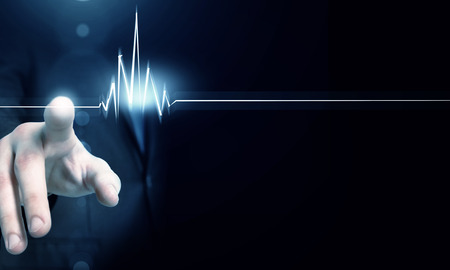 Foto per Male hand touch heart pulse on futuristic interface - Immagine Royalty Free