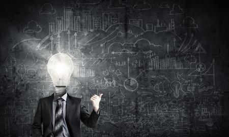 Photo pour Idea concept with businessman and light bulb instead of his head - image libre de droit