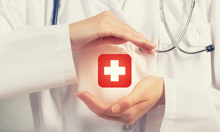 Foto per Close up of doctor hands with medicine cross sign - Immagine Royalty Free