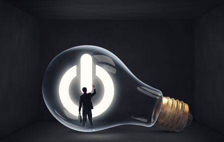 Photo for Man holding luminous idea inside light bulb - Royalty Free Image