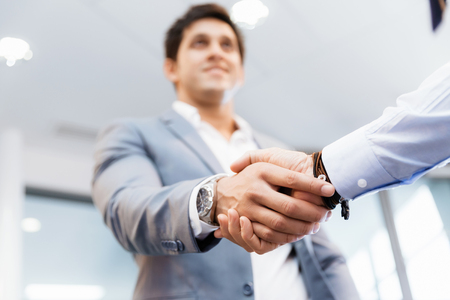 Photo for Handshake of businessmen greeting each other - Royalty Free Image