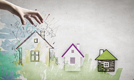 Foto de Human hand grabs drawn on paper house - Imagen libre de derechos