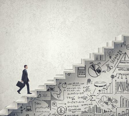 Photo pour Businessman climbing up staircase as symbol of career rise - image libre de droit