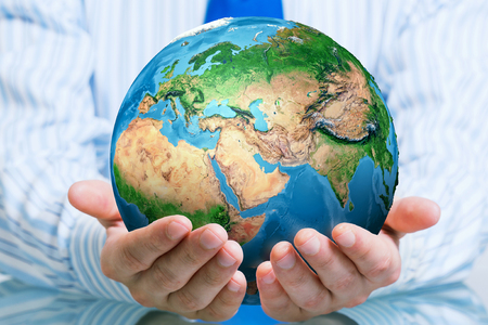 Photo pour Businessman hands holding Earth planet. Elements of this image are furnished by NASA - image libre de droit