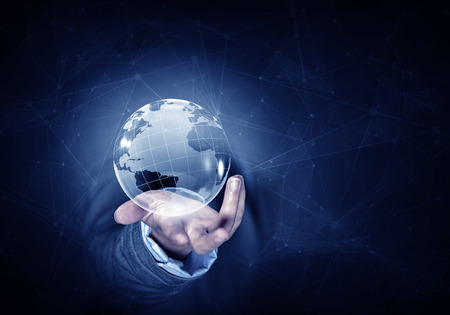 Foto de Man hand holding digital Earth planet representing global technologies concept - Imagen libre de derechos